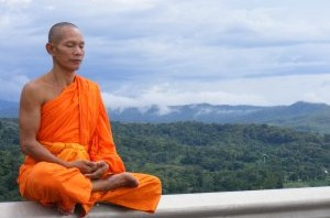Humble Confidence: Buddhist monk meditating with humble confidence.