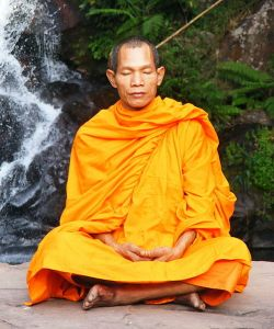 Now: Buddhist monk contemplating the now.
