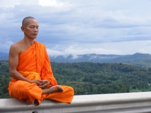 Positive mental attitude: Monk meditating