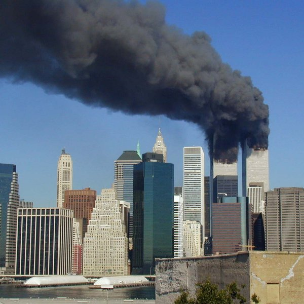 9/11 scene in New York City, with Twin Towers burning. September 11 became a day of infamy.