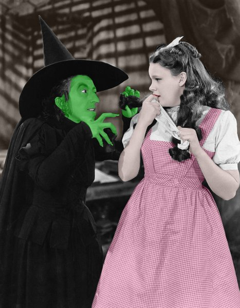 Scene from Wizard of Oz with Wicked Witch and Dorothy.