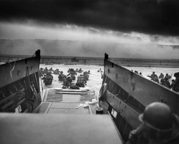 Troops leaving landing craft on D-Day, Omaha Beach.