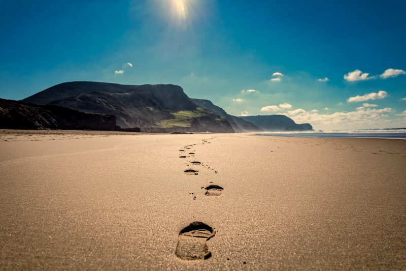 Footsteps on beach, finding the right path.